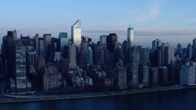 waterfront skyscrapers of midtown east in manhattan, new york city. - citigroup center manhattan stock videos & royalty-free footage