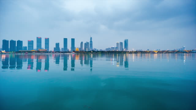 waterfront view of developing city skyline reflection - jiangsu province stock videos & royalty-free footage