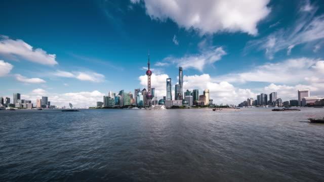 waterfront view of landmark urban skyline daytime transition - lujiazui stock videos & royalty-free footage