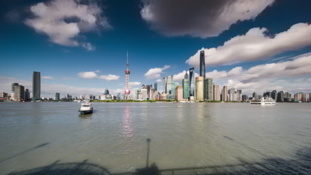 waterfront view of shanghai huangpu river and urban skyline daytime transition - river huangpu stock videos & royalty-free footage
