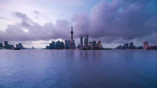 waterfront view of shanghai urban skyline dawn to day transition - 東方明珠塔点の映像素材/bロール