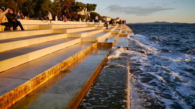 waterfront with steps in zadar, croatia - クロアチア点の映像素材/bロール