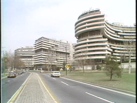 watergate hotel complex with traffic driving down in washington dc in the 1970s. - 1970 1979 stock videos & royalty-free footage
