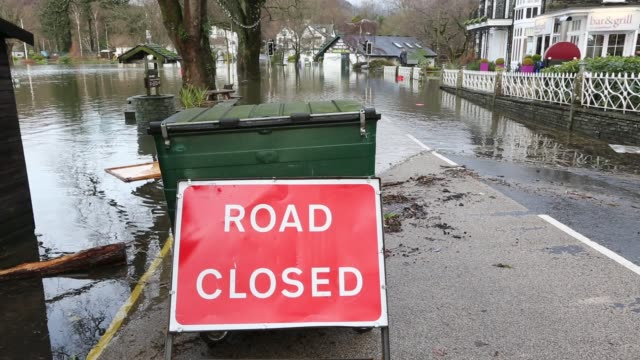 waterhead in ambleside submerged by flood water after lake windermere burst its banks in ambleside in the lake district on sunday 6th december 2015... - road closed sign stock videos & royalty-free footage