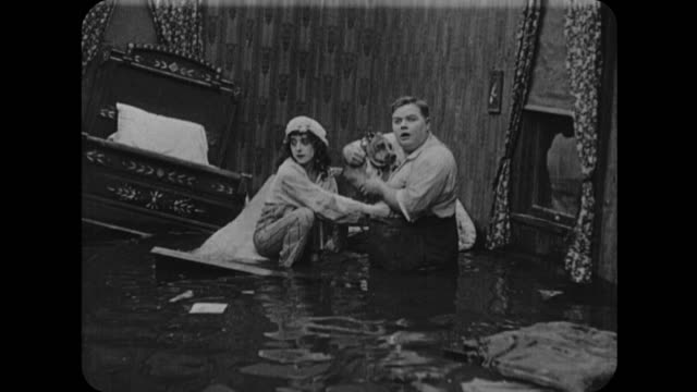 1916 waterlogged couple (fatty arbuckle and mabel normand) in floating house - 1916 stock videos & royalty-free footage