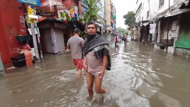 waterlogged road after monsoon rain on august 172019 in kolkata city indiameteorological department predicted heavy rain and thunderstorm in west... - west bengal stock videos and b-roll footage