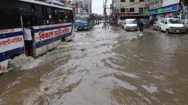 waterlogged street following heavy rain at karwan bazar area in dhaka - bangladesh stock videos & royalty-free footage