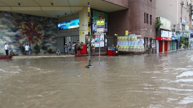 waterlogging in dhaka vehicles wade through water on a dhaka street after heavy rainfall causing immense suffering to the city dwellers this video... - dhaka stock videos and b-roll footage