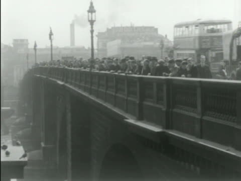 waterloo bridge over thames river houses of parliament clock tower distant bg angled ws people standing along bridge railing street sweeper sweeping... - distant stock videos & royalty-free footage