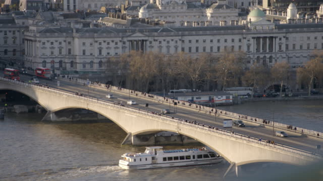 waterloo bridge with commuters and river boat in 2019 - the strand london stock videos and b-roll footage