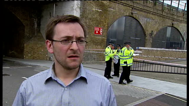 waterloo: ext police vehicles and police officers in street near scene of callum hall shooting incident daniel bradley interview sot armed police... - ツレス点の映像素材/bロール