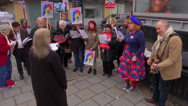 Waterloo residents oppose Mama Mia themed nightclub ENGLAND London Waterloo EXT Various of protesters gathered to oppose the development of the 'Mama...