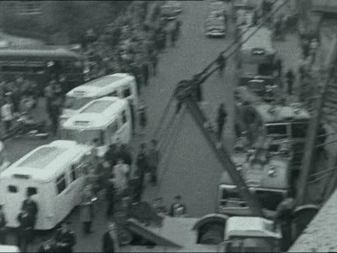 waterloo train crash; england: london: lambeth: nr waterloo: impact point - wreckage tender and front of train two firemen carry man on stretcher... - itv late evening bulletin点の映像素材/bロール