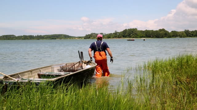 WS DS Waterman Dragging Small Boat Out to Inlet / Oyster, Virginia, USA