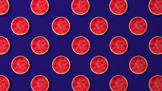 watermelon slice spinning pattern on blue background - juicy stock videos & royalty-free footage