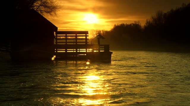 hd slow motion: watermill at sunrise - water wheel stock videos and b-roll footage