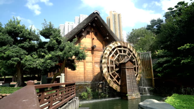 watermill in nan lian garden, hong kong - water wheel stock videos and b-roll footage