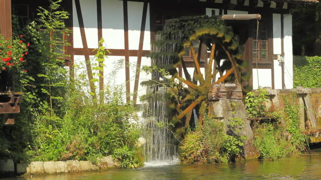 CU Watermill on Blautopf (source of river Blau), Blaubeuren, Allgaeu, Germany