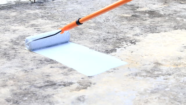 waterproofing - paint roller stock videos & royalty-free footage