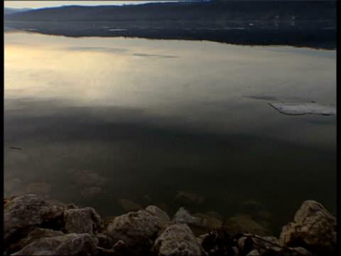 water's edge river where victim's bodies were dumped in truck - slobodan milosevic stock-videos und b-roll-filmmaterial