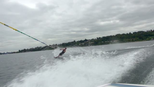 Water-skier Holding On The Rope With One Hand