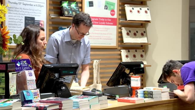 waterstones and foyles bookshops england london piccadilly int customers browsing books in waterstones piccadilly book shop / books on display tables... - book shop stock videos & royalty-free footage