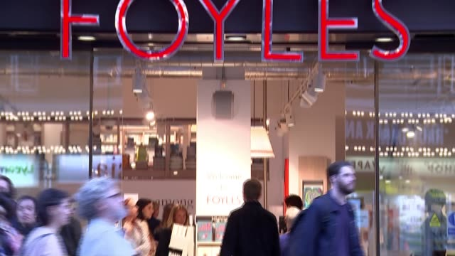 waterstones announces takeover of foyle's england london charing cross road ext foyle's sign as people walking through entrance woman reading book - charing cross stock videos and b-roll footage