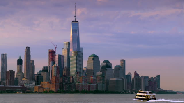 NY Waterway Ferry moves across Hudson River towards Lower Manhattan.