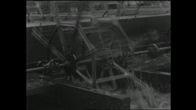 a waterwheel spins at the mikawashima sewage disposal plant. - sewage treatment plant stock videos & royalty-free footage