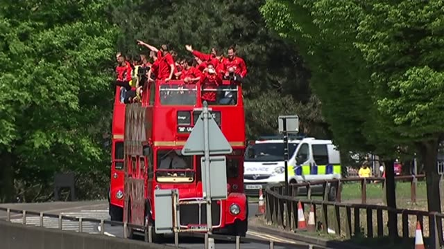 Watford open top bus parade to celebrate their promotion to the Premier League ENGLAND London Watford EXT Various shots Watford football team along...
