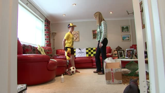 watford v manchester city fa cup final buildup england int rio woolf interview sot close shots of watford fc emblem on rio's prosthetic leg rio woolf... - home interior stock videos & royalty-free footage