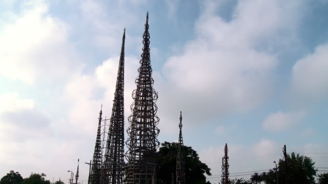 T/L MS Watts Towers against white clouds moving on blue sky, Los Angeles, California, USA