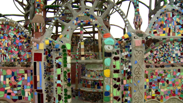 CU TU Watts Towers with ceramic mosaics and broken glass and pottery pieces decorations, Los Angeles, California, USA