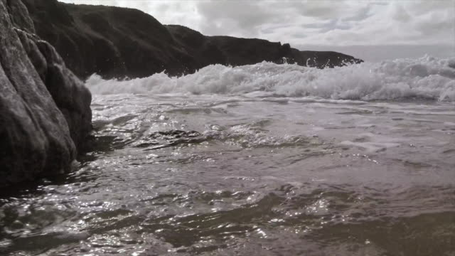 wave break into rocks - english channel stock videos and b-roll footage