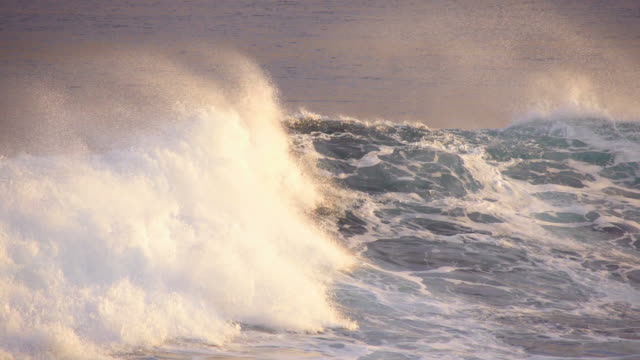 Wave breaking at sunrise light