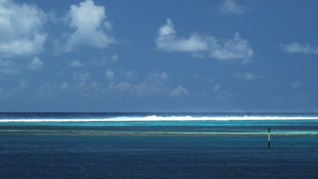 wave breaking on an outer reef - huahine island stock videos and b-roll footage