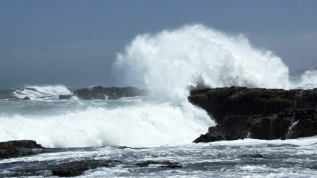 wave crashes against rock - spraying stock videos & royalty-free footage