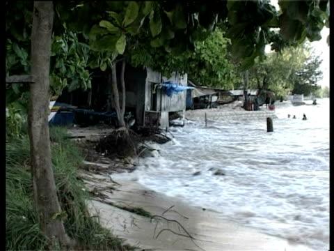 Wave crashing onto beach, Kiribati, Central Pacific.