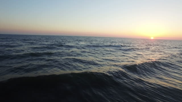 Wave in the sunset