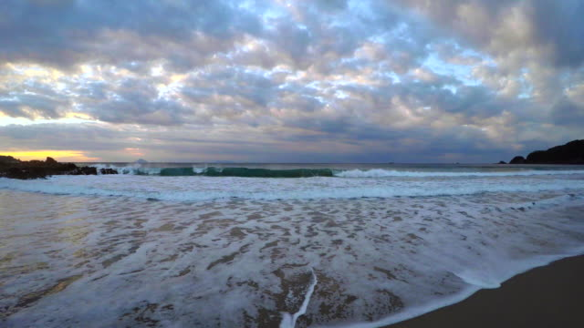 wave on the beach at morning and sunrise  -4k- - plusphoto stock videos & royalty-free footage