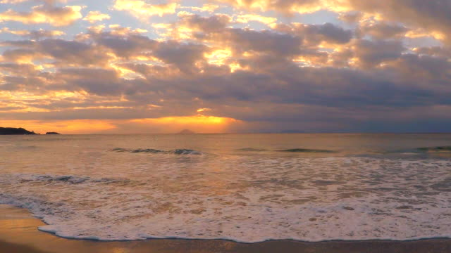 Wave on the beach at morning and sunrise