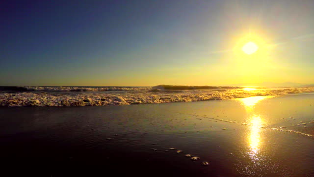 Wave on the beach at sunset  -4K-
