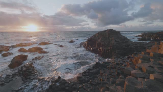 wave smashing giant causeway stone,northern ireland - seascape stock videos & royalty-free footage