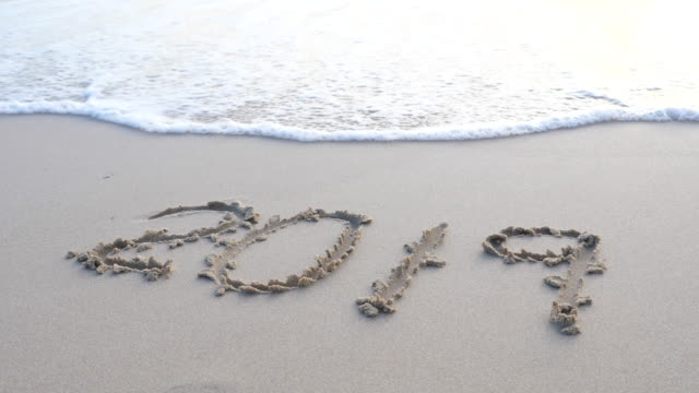 wave splash on 2019, the inscription 2019 on the sand is washed away by the sea wave stock video - 2019 stock videos & royalty-free footage