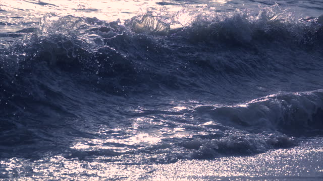 wave splashing on beach slow motion - wake water stock videos & royalty-free footage