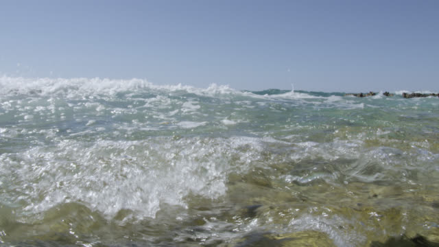 wave submerges camera on tropical beach, bahamas - bimini stock videos & royalty-free footage