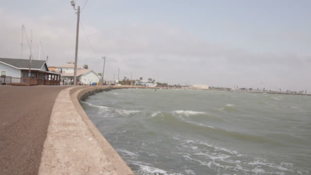 waves against a breaker on a pier. - corpus christi texas stock videos & royalty-free footage