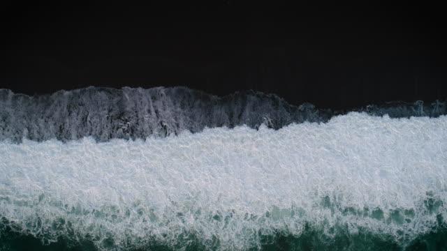 waves at black sand beach. - atlantic ocean stock videos & royalty-free footage