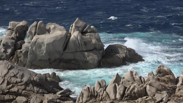 waves beating granite rocks on capo testa - sassari stock videos & royalty-free footage