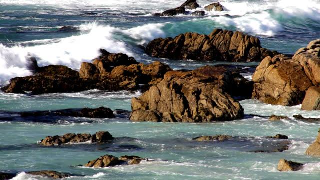 Waves break along California coast